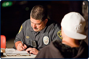 Image of an Officer writing a ticket