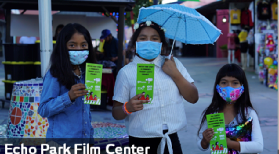 Image of three girls at the echo film center holding brochures