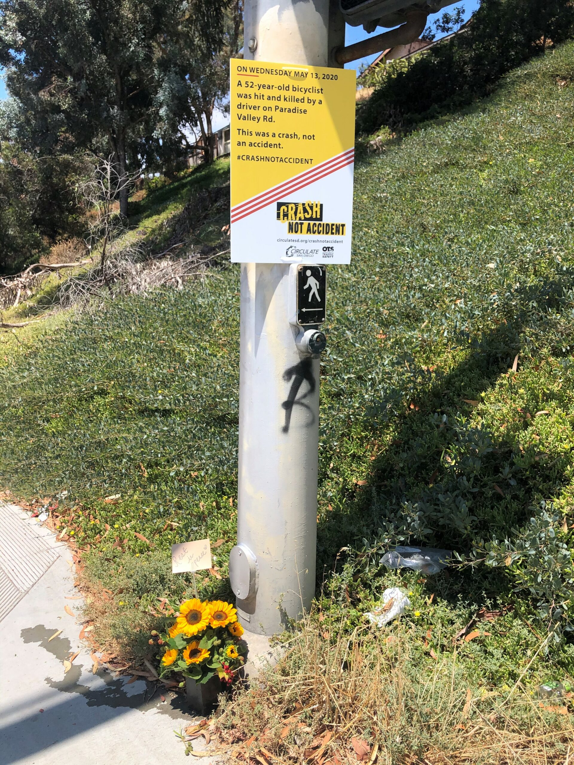 Image of memorial with flowers at scene of deadly crash